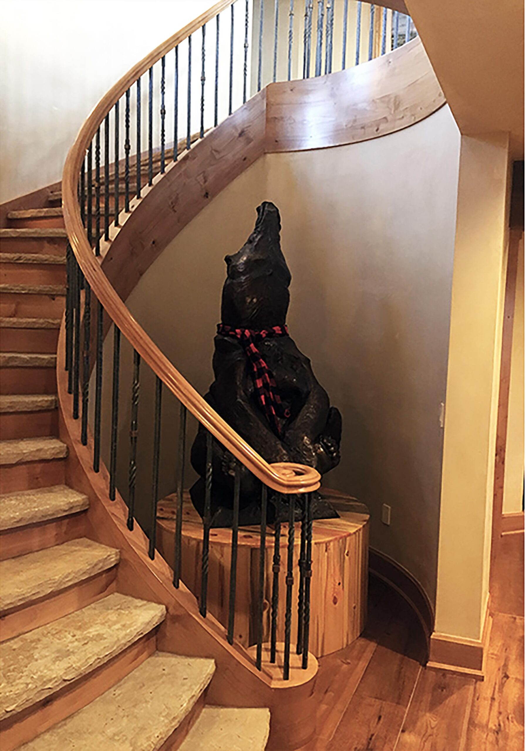 Custom Forged and Finished Interior Rail on Custom Wood Curved Staircase